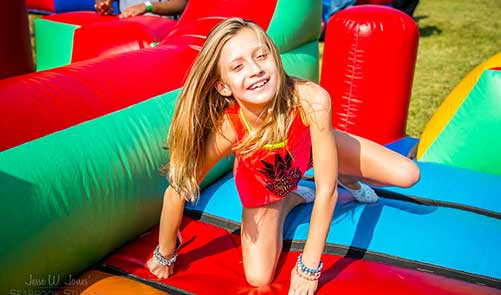 Girl on Bounce House at Celebration Seabrook